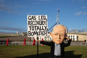Extinction Rebellion protestors on the front lawns of Parliament House in Canberra this morning