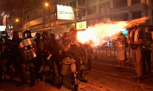 Riot police shoot teargas into crowds of protesters in Hong Kong on Saturday night.