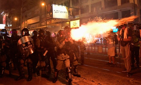 Riot police fire teargas at Hong Kong protesters as unrest escalates