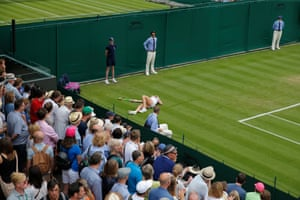 Kiki Bertens lies on the ground after a fall on Court 8 in her first round defeat to Sorana Cirstea