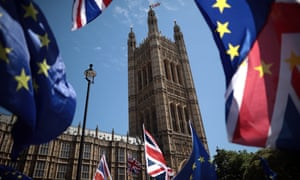 EU and Union Jack flags are waved outside the Houses of Parliament in London