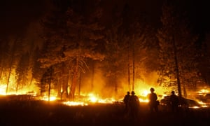 A firefighter lights a backfire to stop the Caldor fire from spreading near South Lake Tahoe.