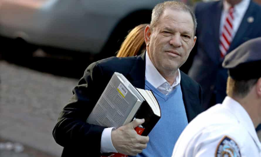 Harvey Weinstein arrives at a New York City police department precinct to turn himself in to face multiple charges related to allegations of sexual assault.