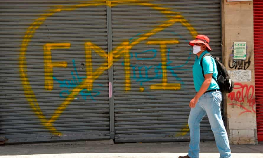 ECUADOR-HEALTH-VIRUS-PROTEST<br>A worker marches in downtown Quito, on May 18, 2020, to protest against a law that proposes labour reforms to alleviate the economic impact of the Covid-19 coronavirus pandemic. (Photo by Rodrigo BUENDIA / AFP) (Photo by RODRIGO BUENDIA/AFP via Getty Images)
