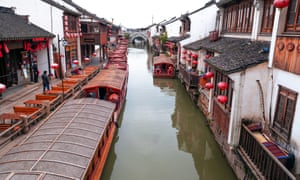 Houses with red lanterns by the canal in Suzhou.