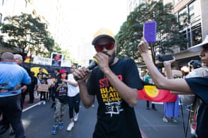 Paul Silva leads the march down Park Street, Sydney during the Stop Black Deaths in Custody protest