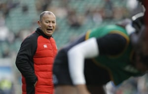 Eddie Jones directs his players before the start.
