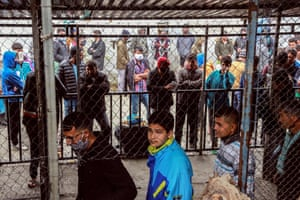Migrants and refugees queue in a makeshift camp next to the Moria camp on the Greek island of Lesbos on 2 April.