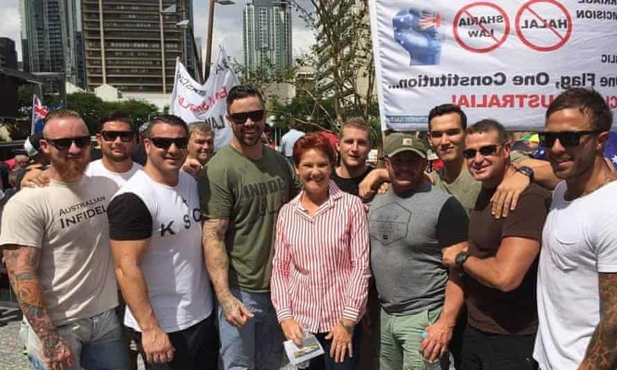 Employees of Wilson Security's Nauru emergency response team and others at the Reclaim Australia rally in Brisbane on April 4. From left: Dan Connors, Cody Allen, Alan Hartley, Beau James, former federal MP Pauline Hanson (centre), Motley, Simon Scott (in light green shirt not a Wilson employee), Jamie Scannell, Harley Levanic, (other male in navy blue shirt not a Wilson employee).