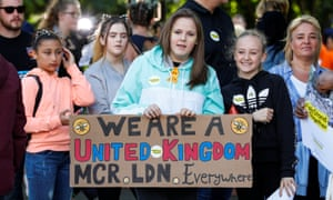 Music fans show off their banner as they arrive at the One Love Manchester concert.