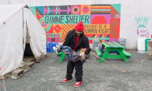 D'Arion Daniel plays with ZyCorey in Othello Village, a village of tiny homes for homeless people in Seattle.