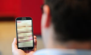 """Revenge porn lawsPICTURE POSED BY MODEL Undated photo of a man looking at a mobile phone, as so-called revenge porn is being targeted in a new Bill introduced by the Scottish Government today. PRESS ASSOCIATION Photo. Issue date: Friday October 9, 2015. Scotland's top prosecutor, the Lord Advocate, welcomed the move to tackle the """"form of insidious abuse"""" - often against women - which in some cases has led to people taking their own lives. See PA story LEGAL RevengePorn. Photo credit should read: PA Wire"""