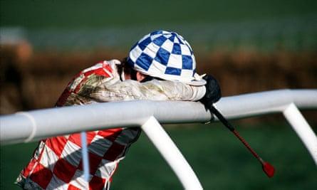 A jockey hangs in head in despair