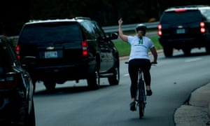 After Juli Briskman gave Trump's motorcade the finger, her employer sacked her, citing her re-posting of the 'obscene' image on her Twitter account.