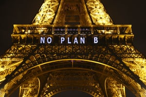 The slogan 'no plan b' is projected on to the Eiffel Tower in Paris, France