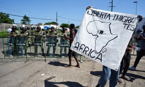 African migrants protest outside the Siglo XXI migrants detention center, demanding Mexican authorities to speed up visas that would enable them to cross Mexico to the US.
