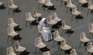 A nun waits for Pope Francis' weekly general audience in San Damaso courtyard at the Vatican today