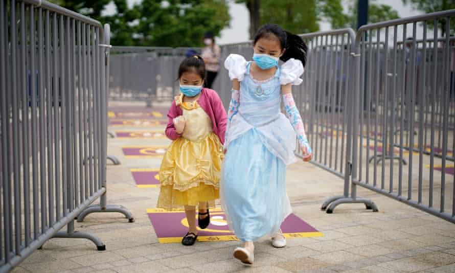 Two children at Disney's Shanghai theme park.