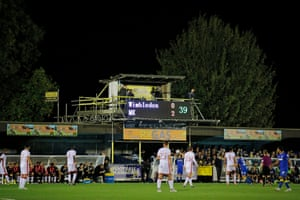 The scoreboard shows score with the away side just called MK