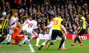 Etienne Capoue from Watford takes the ball into the net to open the scoring.