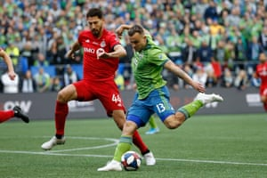 MLS: MLS Cup-Toronto FC vs Seattle FCNovember 10, 2019; Seattle, WA, USA; Seattle Sounders forward Jordan Morris (13) kicks the ball against Toronto FC defender Omar Gonzalez (44) in the first half during the MLS Cup at CenturyLink Field. Mandatory Credit: Joe Nicholson-USA TODAY Sports