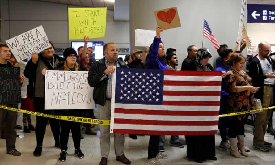 Protesters at at Dallas-Fort Worth International Airport denounce President Trump's executive order on immigration.