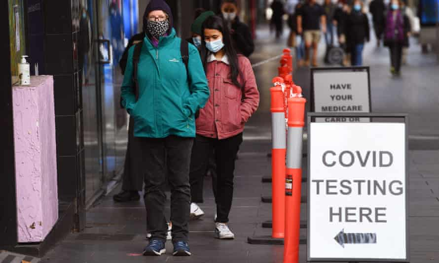 People wait in queues at a Covid-19 testing centre in Melbourne on May 26, 2021, as Australia's second biggest city scrambles to contain a growing Covid outbreak.