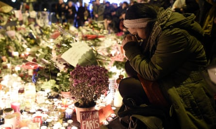 A woman at the makeshift memorial in front of the Bataclan theatre after the terrorist attacks in Paris.