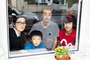 Kazue Ono and husband Tatsuya with their children Kosuke and Arata