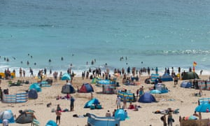People head to the beach during the hot weather in August.