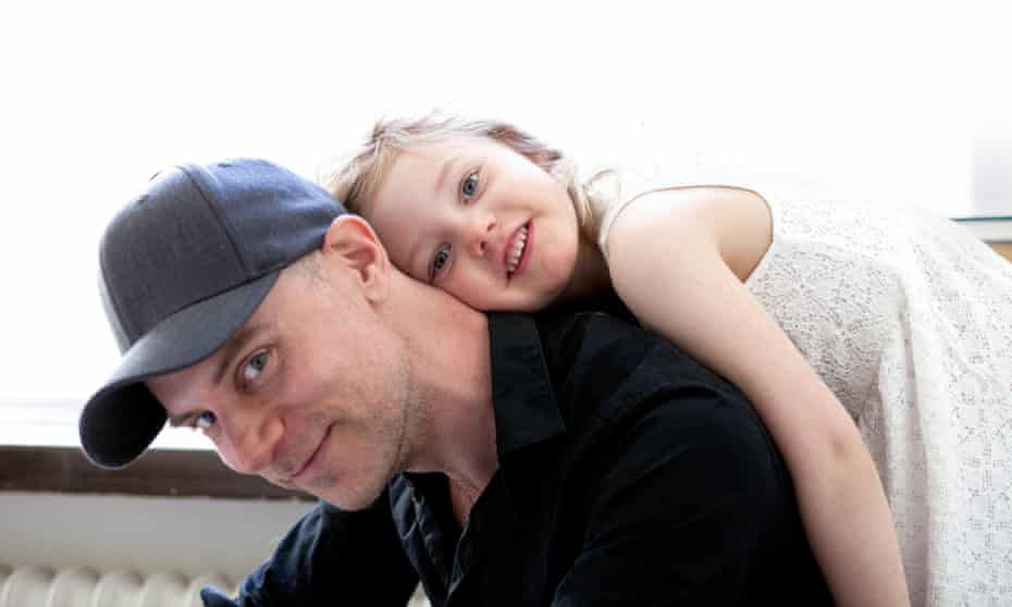 Tom Malmquist with his daughter, Livia, at home in Stockholm.