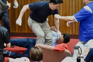 Lu Ming-che, a KMT legislator, falls to the ground