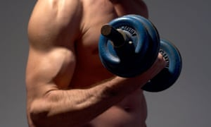 The topless torso of a man lifting weights