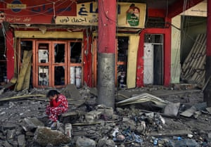 Battle endgame … a girl in the old city in western Mosul, Iraq, near the destroyed Great Mosque of al-Nuri, on 6 July 2017.
