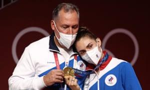 Russian Olympic Committee President Stanislav Pozdnyakov poses with his daughter Sofia Pozdniakova