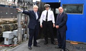 Boris Johnson (left) visiting HMS Vengeance with Defence Secretary Ben Wallace (right)
