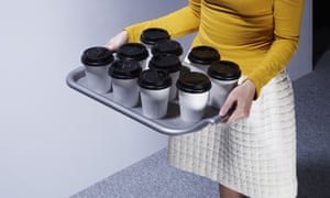 office worker carrying cups of tea