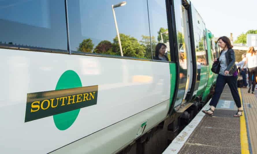 Woman boarding Southern rail train