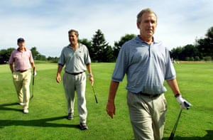 George W Bush, right, with his brother and father in 2001.