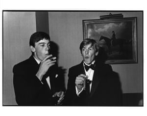 William Nott and Edward Hoare smoking cigars at the Grattan-Bellew/Sebag-Montefiore/Courtauld dance, Boodles, London, 1981.