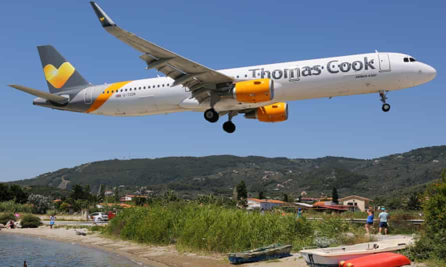 A Thomas Cook jet lands at Skiathos in Greece.