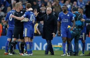 Claudio Ranieri celebrates with his team after the victory over Swansea