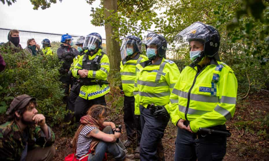 Police officers and environmental protesters in Jones' Hill wood, Wendover, Buckinghamshire