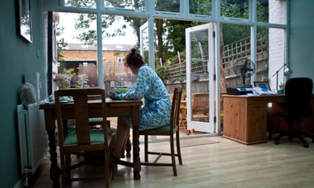 Woman seated at dining table in conservatory