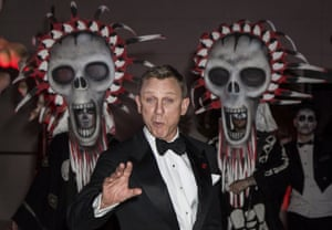 Daniel Craig poses with some scary skeletons at the party