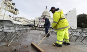 A man sweeps the floor near Capitol Hill ahead of the inauguration