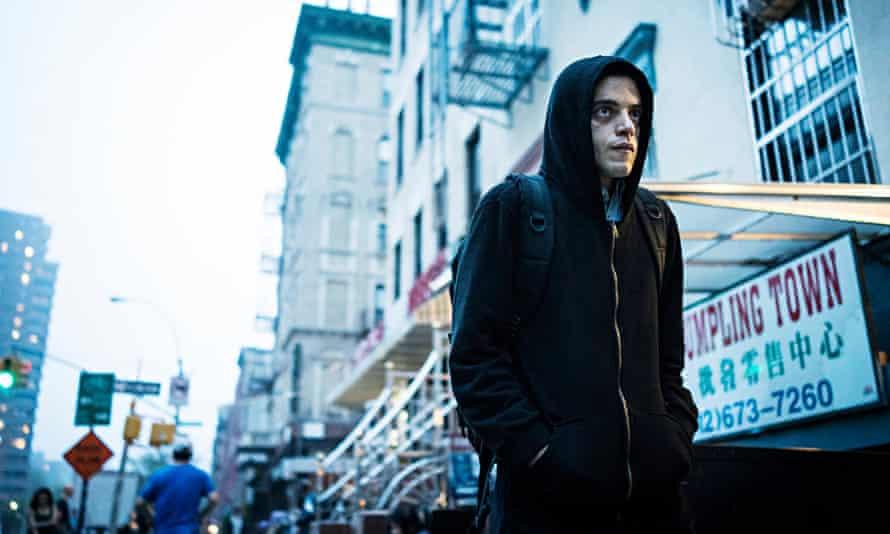 Rami Malek in a hoddie in the street in Mr Robot