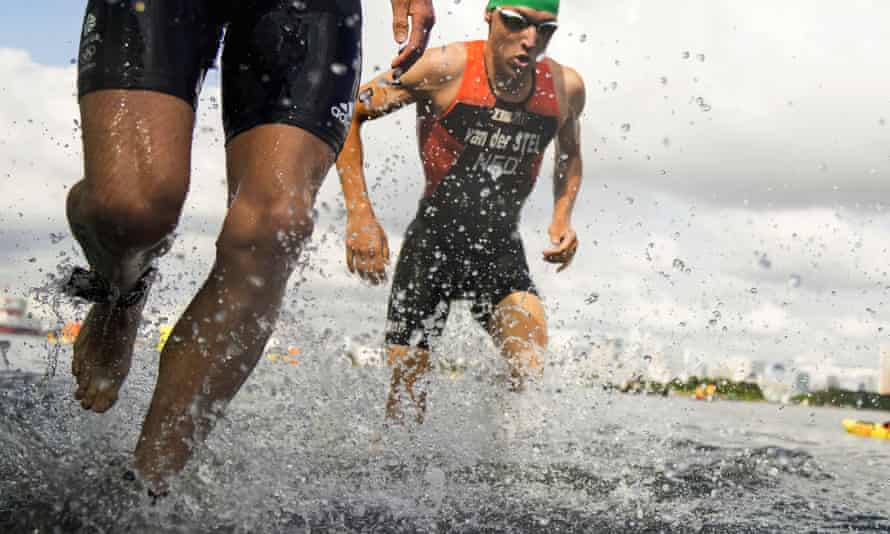 Britain's Jonathan Brownlee, left, and Marco Van Der Stel, of the Netherlands, come out of the water in the mixed triathlon relay.