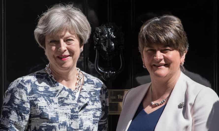 Theresa May and Arlene Foster, right