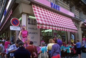 A Tati store selling cheap clothes on stalls in the streets of Montmartre, Paris, in 2005